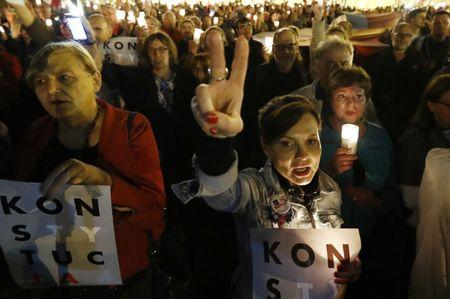 People gather next to the Supreme Court during a protest against judicial reforms in Warsaw
