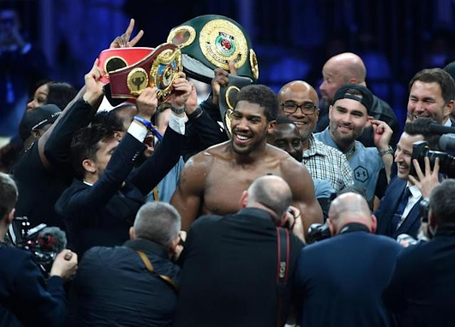 British boxer Anthony Joshua celebrates after regaining his world heavyweight crown with a unanimous points win over Andy Ruiz (AFP Photo/Fayez Nureldine)
