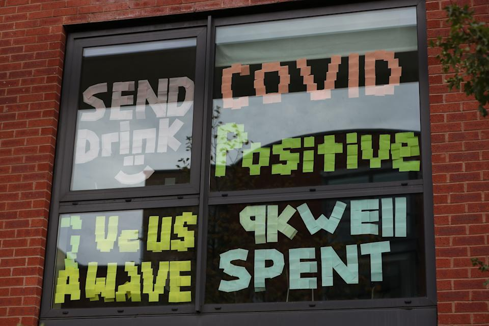 Signs on a window at Manchester Metropolitan University's Birley campus where hundreds of students have been told to self-isolate after 127 of them tested positive for coronavirus.