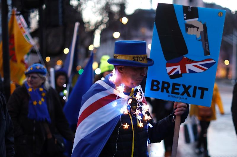 Anti-Brexit protestors gathered outside the Houses of Parliament in London on March 12 ahead of the first of a series of votes on Brexit