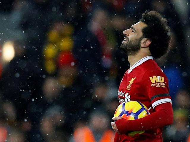 "Soccer Football - Premier League - Liverpool vs Watford - Anfield, Liverpool, Britain - March 17, 2018 Liverpool's Mohamed Salah celebrates with the matchball after the match REUTERS/Phil Noble EDITORIAL USE ONLY. No use with unauthorized audio, video, data, fixture lists, club/league logos or ""live"" services. Online in-match use limited to 75 images, no video emulation. No use in betting, games or single club/league/player publications. Please contact your account representative for further details."