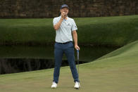 Justin Rose, of England, reacts to missing a birdie putt on the 11th hole during the first round of the Masters golf tournament on Thursday, April 8, 2021, in Augusta, Ga. (AP Photo/David J. Phillip)