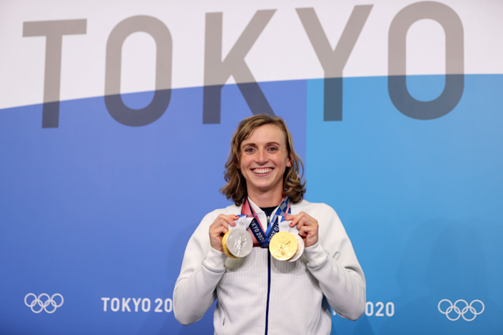 Katie Ledecky of Team USA poses with her medals.