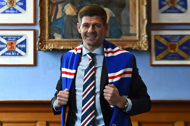 Steven Gerrard has the daunting task at Rangers of toppling Celtic (AFP Photo/ANDY BUCHANAN )