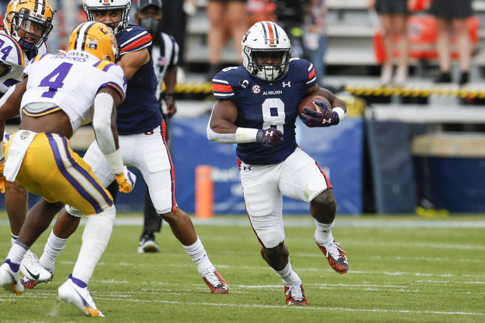 Auburn running back Shaun Shivers (8) carries the ball during the first quarter of an NCAA college football game against LSU on Saturday, Oct. 31, 2020, in Auburn, Ala. (AP Photo/Butch Dill)