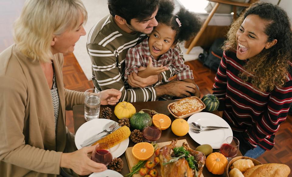 Happy Family Celebrating Thanksgiving Dinner at home . Celebration tradition concept