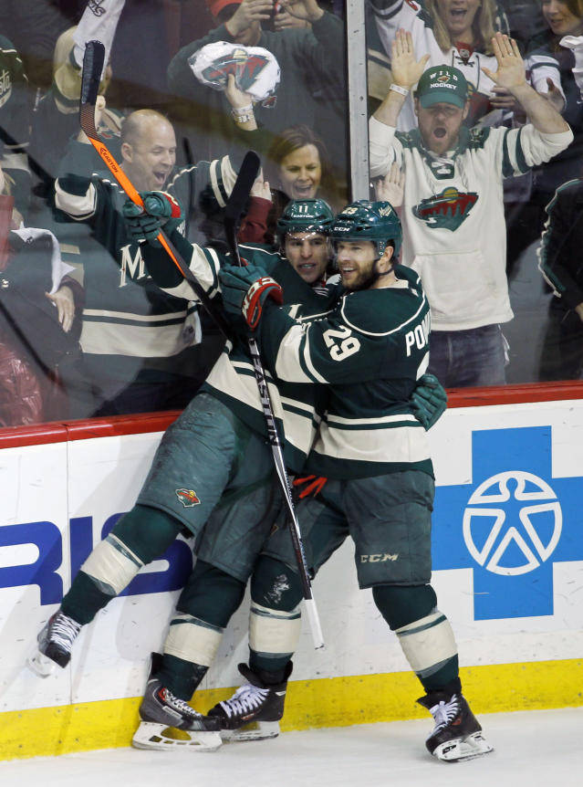 Minnesota Wild left wing Zach Parise, left, celebrates with teammate Jason Pominville (29) after scoring on Chicago Blackhawks goalie Corey Crawford during the third period of Game 3 of an NHL hockey second-round playoff series in St. Paul, Minn., Tuesday, May 6, 2014. The Wild won 4-0. (AP Photo/Ann Heisenfelt)