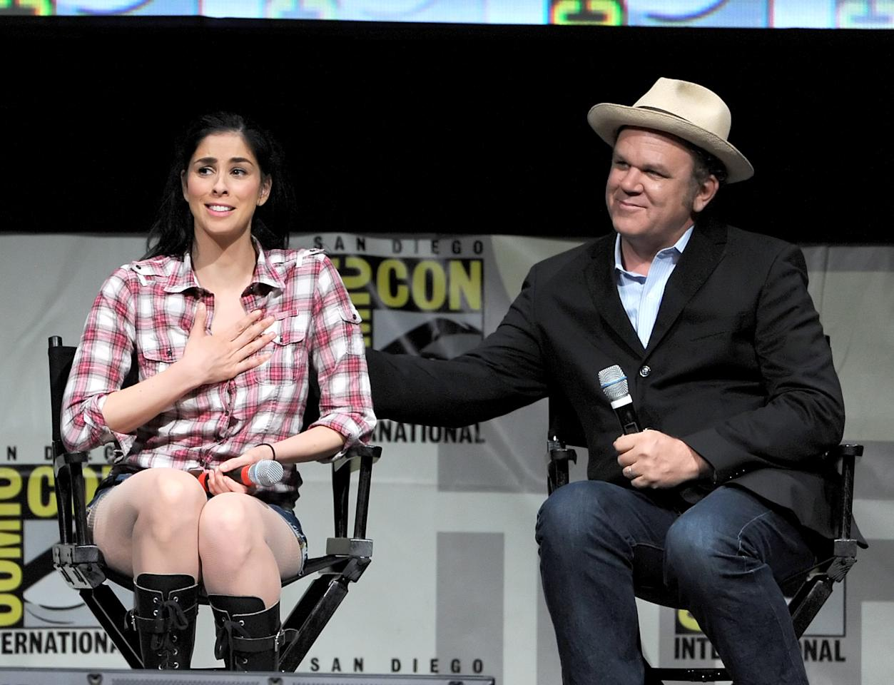 "SAN DIEGO, CA - JULY 12:  Actress Sarah Silverman (L) and actor John C. Reilly speak at the ""Wreck-It Ralph"" panel during Comic-Con International 2012 at San Diego Convention Center on July 12, 2012 in San Diego, California.  (Photo by Kevin Winter/Getty Images)"
