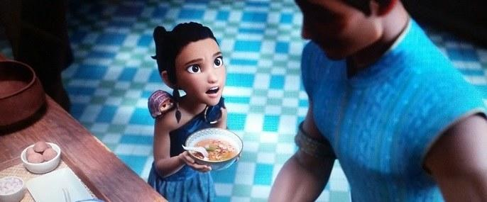 Raya looks up at her Ba while holding a bowl of tom yum soup he just made for her