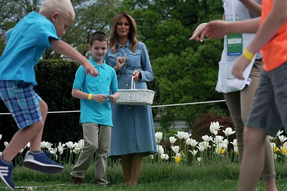 Melania Trump wore a denim Michael Kors dress for the 141st Easter Egg Roll on the South Lawn of the White House. [Photo: Getty]