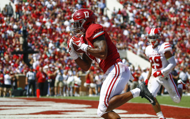 Alabama wide receiver Jaylen Waddle (17) catches a pass for a touchdown against Louisiana-Lafayette during the first half of an NCAA college football game, Saturday, Sept. 29, 2018, in Tuscaloosa, Ala. (AP Photo/Butch Dill)