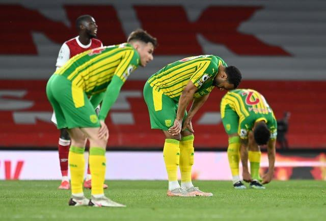 West Bromwich Albion players look dejected after relegation was confirmed