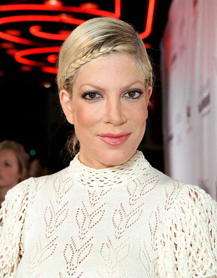 "Not only is Tori Spelling's crocheted top nightmare-inducing, so is her braided coif. Todd Williamson/<a href=""http://www.wireimage.com"" target=""new"">WireImage.com</a> - December 10, 2008"