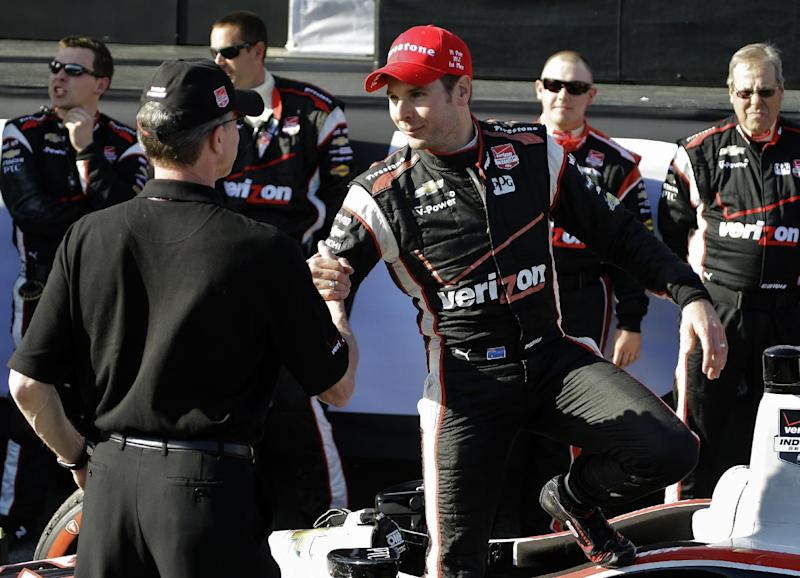 Will Power, center, of Australia, shakes hands with crew members after winning the IndyCar Grand Prix of St. Petersburg auto race Sunday, March 30, 2014, in St. Petersburg, Fla. (AP Photo/Chris O'Meara)