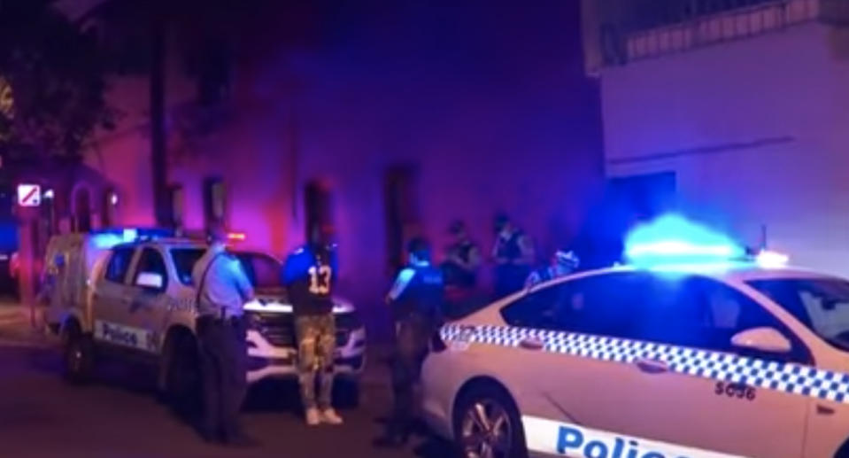 Police arrest a man in Surry Hills, Sydney.