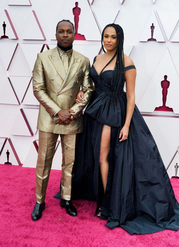 <p>The One Night In Miami actor was Oscars-appropriate in an all-gold look by Brioni. Robinson, who accompanied her husband on the red carpet, wore a black off-the-shoulder dress by Zuhair Murad.</p>