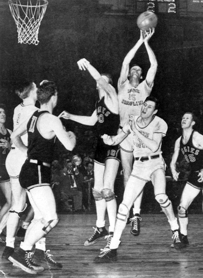General view of some players of the University of North Carolina Tar Heels rebounding the ball during the 1946 Championship game at the Dean E. Smith Center in Chapel Hill, North Carolina.