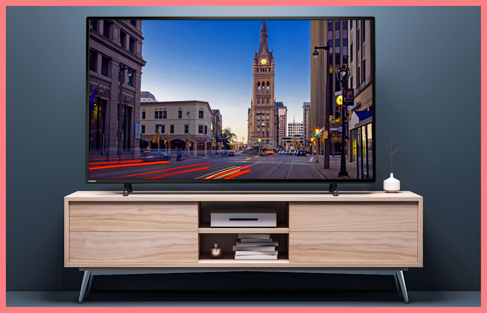 The furniture is mid-century modern. The TV? State of the 21st century art. (Photo: Walmart)
