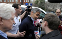 Actor George Clooney, center, and Rep. Jim Moran, D-Va., left, are led to a police vehicle after being arrested during a protest at the Sudan Embassy in Washington, Friday, March 16, 2012. The demonstrators are protesting the escalating humanitarian emergency in Sudan that threatens the lives of 500,000 people. (AP Photo/Cliff Owen)