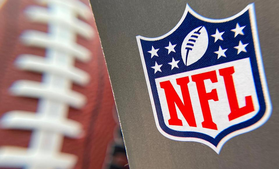 In this file photo taken on August 24, 2020 the NFL logo is seen on a football packaging in Los Angeles.