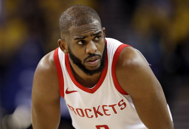 Chris Paul came up limping late in Houston's Game 5 win over Golden State and did not play in the final seconds after colliding with Quinn Cook. (AP)