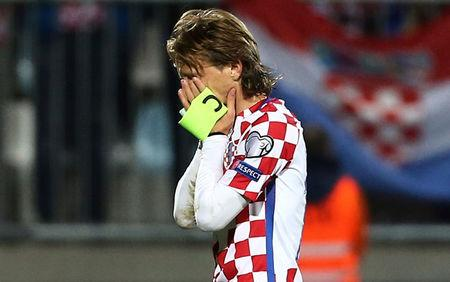 Croatia's Luka Modric looks dejected after the match    REUTERS/Antonio Bronic
