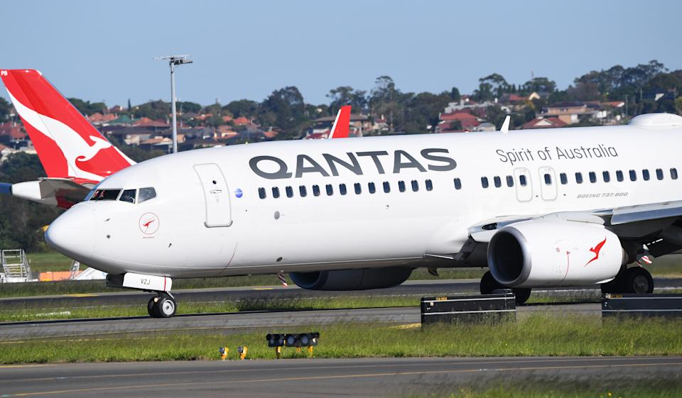 SYDNEY, AUSTRALIA - APRIL 17: A Qantas Boeing 737-800 aircraft lands at Sydney Airport on April 17, 2020 in Sydney, Australia. The federal government on Thursday announced a $165 million package to assist Qantas and Virgin Australia continue to offer domestic flights to maintain connections with capital cities. Prime Minister Scott Morrison on Thursday flagged that current restrictions in place to stop the spread of COVID-19 could be lifted in four weeks, should Australia's infection rate continue to flatten. Currently, all non-essential business are closed and strict social distancing rules are in place, while public gatherings are limited to two people. New South Wales and Victoria have enacted additional lockdown measures to allow police the power to fine people who breach the two-person outdoor gathering limit or leave their homes without a reasonable excuse. Queensland, Western Australia, South Australia, Tasmania and the Northern Territory have all closed their borders to non-essential travellers and international arrivals into Australia are being sent to mandatory quarantine in hotels for 14 days. (Photo by James D. Morgan/Getty Images)