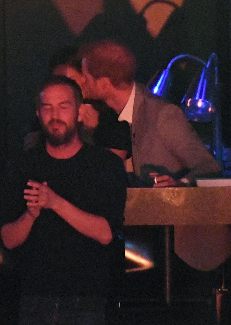 <p>After a year of dating, Prince Harry couldn't help but sneak a kiss with his girlfriend during the Invictus Games Toronto 2017 celebrations in September. Their mutual friend Markus Anderson was also in attendance but couldn't quite hide their smooch. </p>