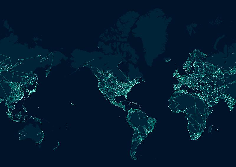 A map of the globe lit up by lights around major cities as if seen from space at night.
