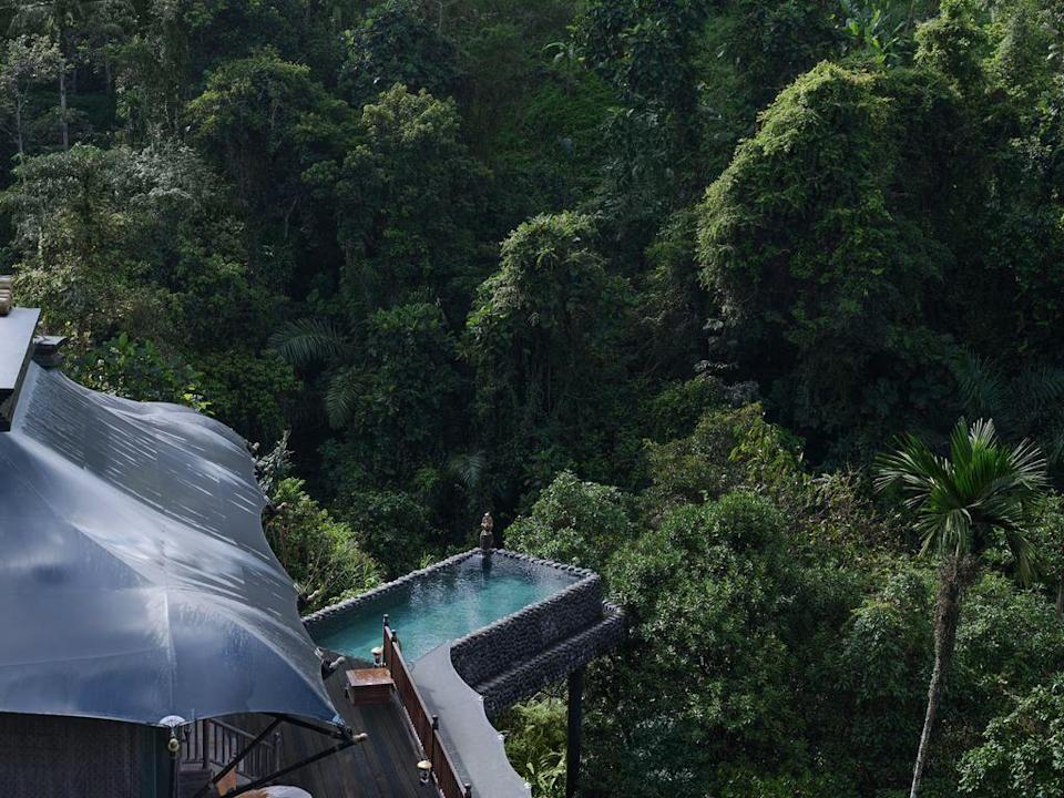 """<p>Can we take a moment for this spectacular pool, situated on stilts in the middle of the jungle? The breathtaking pool comes attached to a uniquely-decorated luxury tent, complete with outdoor shower and more.</p><p>Book via: <a href=""""https://www.capellahotels.com/en/capella-ubud"""" rel=""""nofollow noopener"""" target=""""_blank"""" data-ylk=""""slk:Capella"""" class=""""link rapid-noclick-resp"""">Capella</a></p>"""