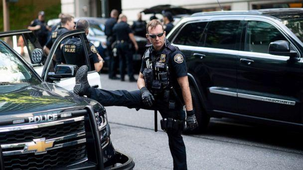 PHOTO: Portland police officer Bonczijk stretches before the start of a protest in Portland, Ore., on Saturday, Aug. 17, 2019. (Noah Berger/AP Photo)
