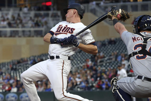 Minnesota Twins' Max Kepler, left, rears back from a close pitch caught by Detroit Tigers' James McCann in fourth inning of a baseball game Monday, May 21, 2018, in Minneapolis. (AP Photo/Jim Mone)
