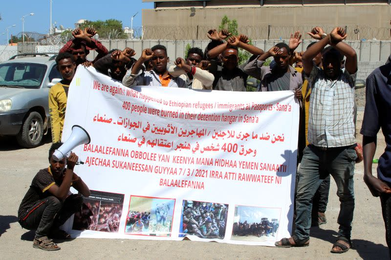 Ethiopian migrants gather to protest their treatment in the war-torn country during a sit-in outside a compound of United Nations organizations in the southern port city of Aden