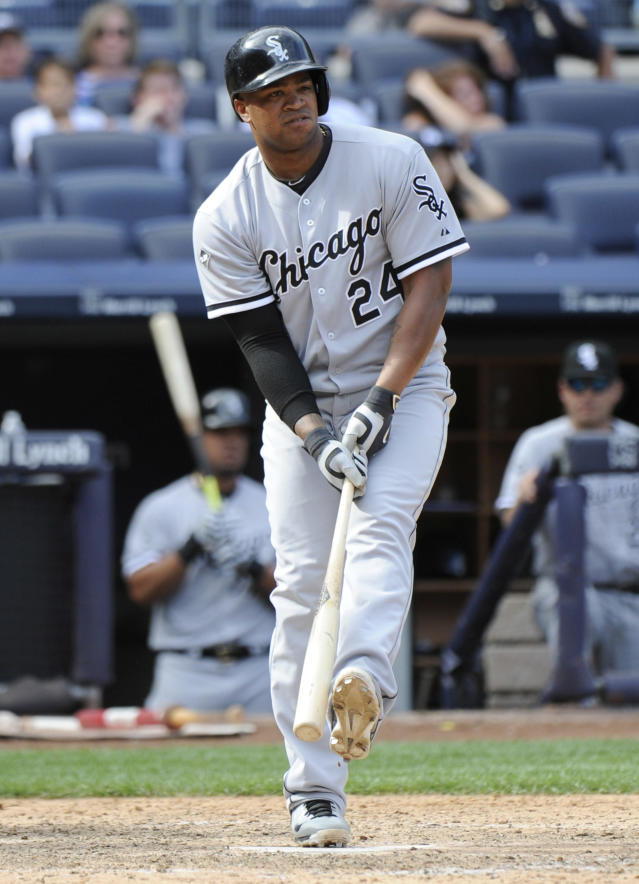 Chicago White Sox pinch hitter Dayan Viciedo reacts after striking out during the ninth inning of a baseball game against the New York Yankees Saturday, Aug. 23, 2014, at Yankee Stadium in New York. The Yankees won 5-3. (AP Photo/Bill Kostroun)