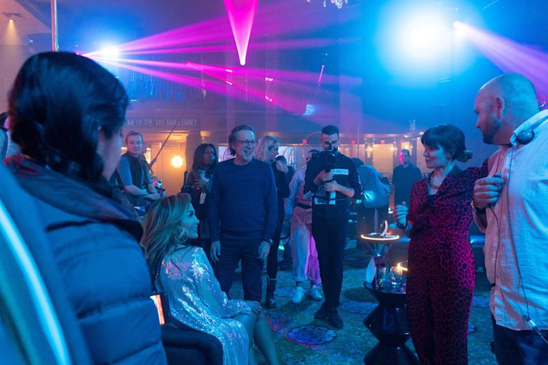 HUSTLERS, seated at left: Jennifer Lopez; at right, in animal print clothing: director Lorene Scafaria, on-set, 2019. ph: Barbara Nitke / STX Entertainment / courtesy Everett Collection
