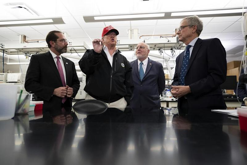 President Donald Trump speaks during a meeting with Health and Human Services Secretary Alex Azar, left, Centers for Disease Control and Prevention Director Robert Redfield, and Associate Director for Laboratory Science and Safety Steve Monroe, about the coronavirus at the Centers for Disease Control and Prevention, Friday, March 6, 2020 in Atlanta.