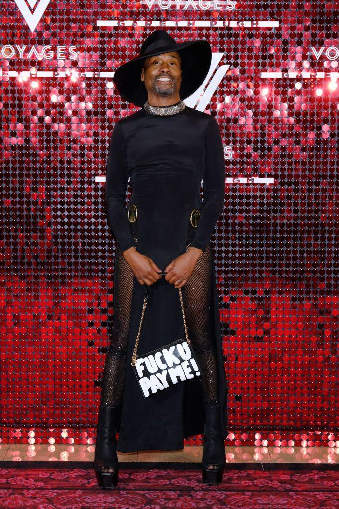 <p>Porter at the Virgin Voyages and Gareth Pugh collaboration launch party in a black dress, fishnet stockings, platform boots, shoulder bag, and wide-brim hat. </p>