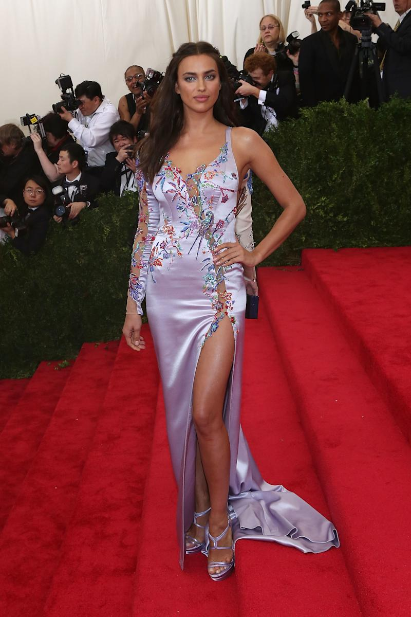 At the 2015 Met Gala, Shayk arrived in a purple silk gown with floral embroidery by Versace.