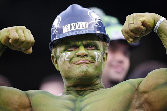 A Seattle Seahawks fan flexes at MetLife Stadium before the NFL Super Bowl XLVIII football game between the Seattle Seahawks and the Denver Broncos Sunday, Feb. 2, 2014, in East Rutherford, N.J. (AP Photo/Evan Vucci)