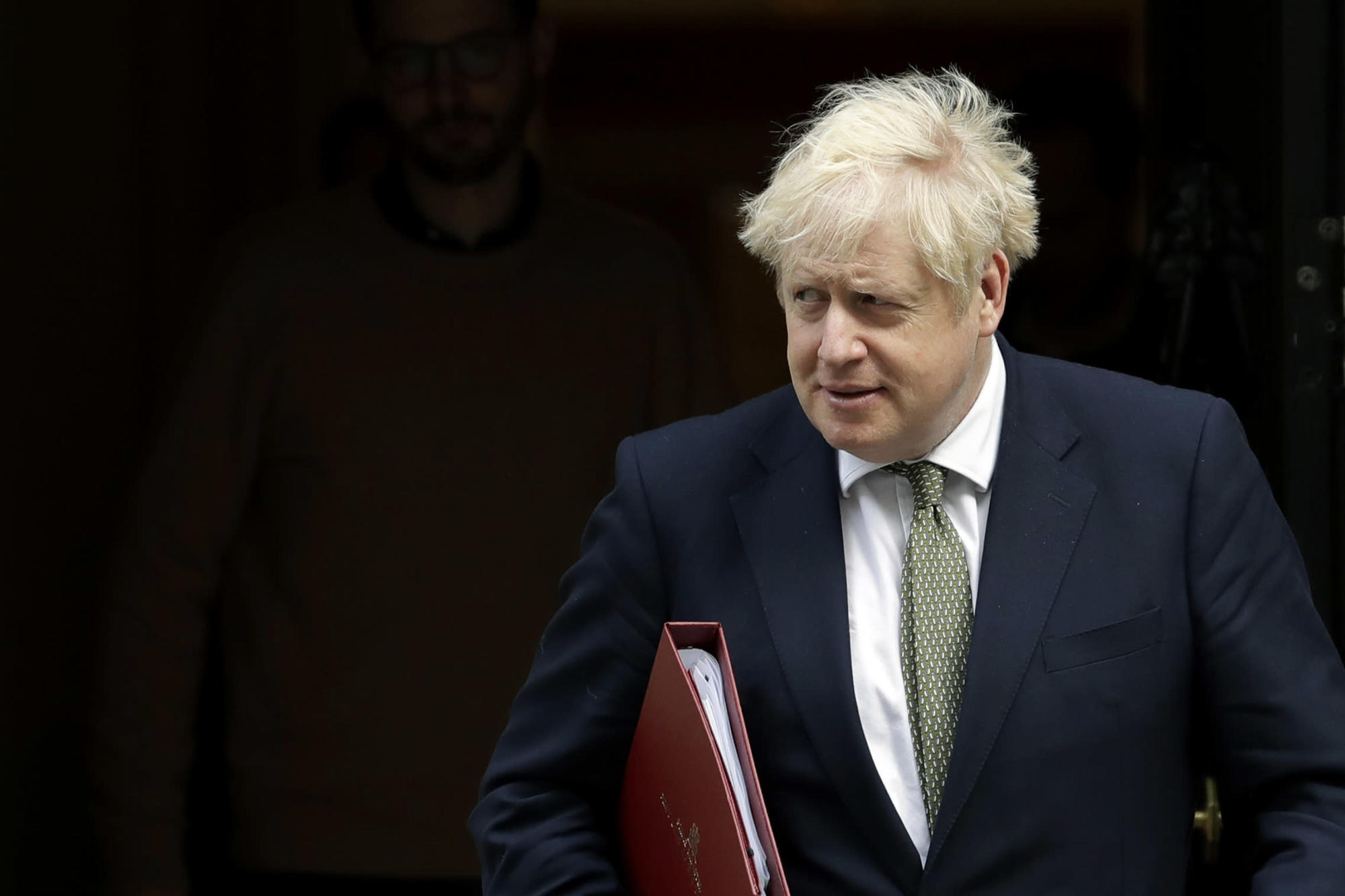 As virus surges, isolated UK leader Johnson faces many foes