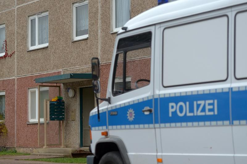 A police vehicle stands in front of a house in Suhl, east Germany, during an anti-terror operation on October 25, 2016