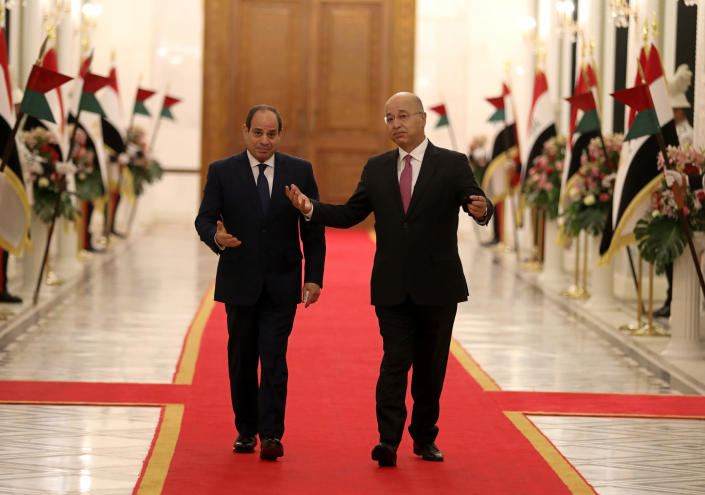 Iraqi President Barham Salih, right, welcomes Egyptian President Abdel Fattah al-Sisi as he arrives at the Baghdad's Presidential Palace, Saturday, Aug. 28, 2021. (AP Photo/Khalid Mohammed)