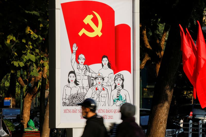 FILE PHOTO: A poster for the13th national congress of the Communist Party of Vietnam is displayed on a street in Hanoi