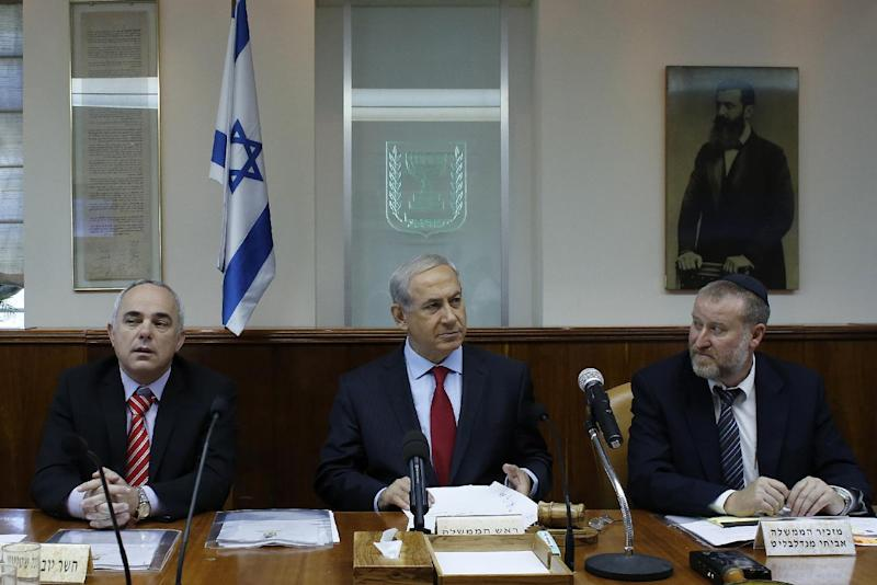 Israel's Prime Minister Benjamin Netanyahu attends the weekly cabinet meeting in Jerusalem, Sept. 17, 2013. Netanyahu will meet U.S. President Barack Obama in Washington on Sept. 30, 2013, for talks expected to focus on Iran's nuclear program, an Israeli official said on Tuesday. (AP Photo/Ammar Awad, Pool)