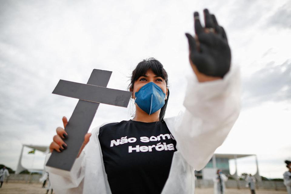A nurse takes part in a demonstration to protest against Brazilian President Jair Bolsonaro and pay tribute to health workers who died from complications of the novel coronavirus COVID-19, in front of Planalto Palace in Brasilia, on May 1, 2021. - Brazil is the most populous population American population affected by the pandemic, with more than 403,781 deaths and 14,659. 011 infections so far. (Photo by Sergio LIMA / AFP) (Photo by SERGIO LIMA/AFP via Getty Images)