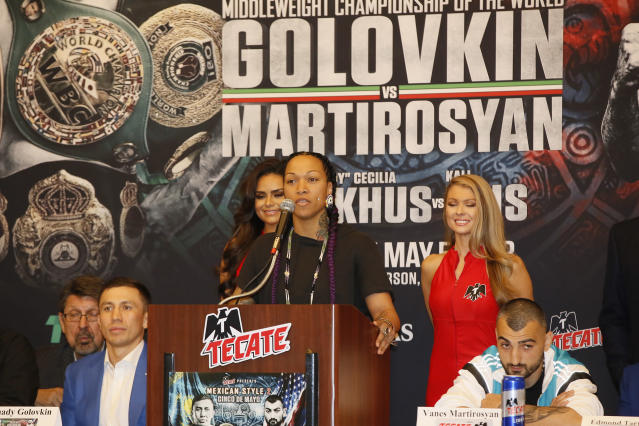 American boxer Kali Reis, at podium, take questions at a news conference in Los Angeles, Wednesday, May 2, 2018. Reis is slated to fight against Norwegian boxing star Cecilia Braekhus during the boxing event at StubHub Center in Carson, Calif., on Saturday, May, 5. (AP Photo/Damian Dovarganes)