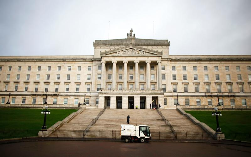 A road sweeper van passes Stormont, Belfast, Northern Ireland - Copyright 2017 The Associated Press. All rights reserved.