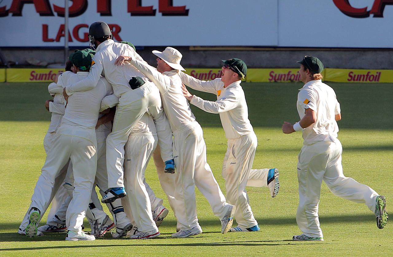 CAPE TOWN, SOUTH AFRICA - MARCH 05: Australia celebrates their win during day 5 of the 3rd Test match between South Africa and Australia at Sahara Park Newlands on March 05, 2014 in Cape Town, South Africa. (Photo by Carl Fourie/Gallo Images/Getty Images)