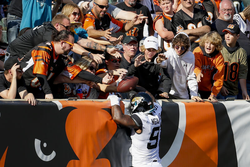 Jacksonville Jaguars defensive end Yannick Ngakoue (91) celebrates his interception and touchdown run in the second half of an NFL football game against the Cincinnati Bengals, Sunday, Oct. 20, 2019, in Cincinnati. (AP Photo/Frank Victores)