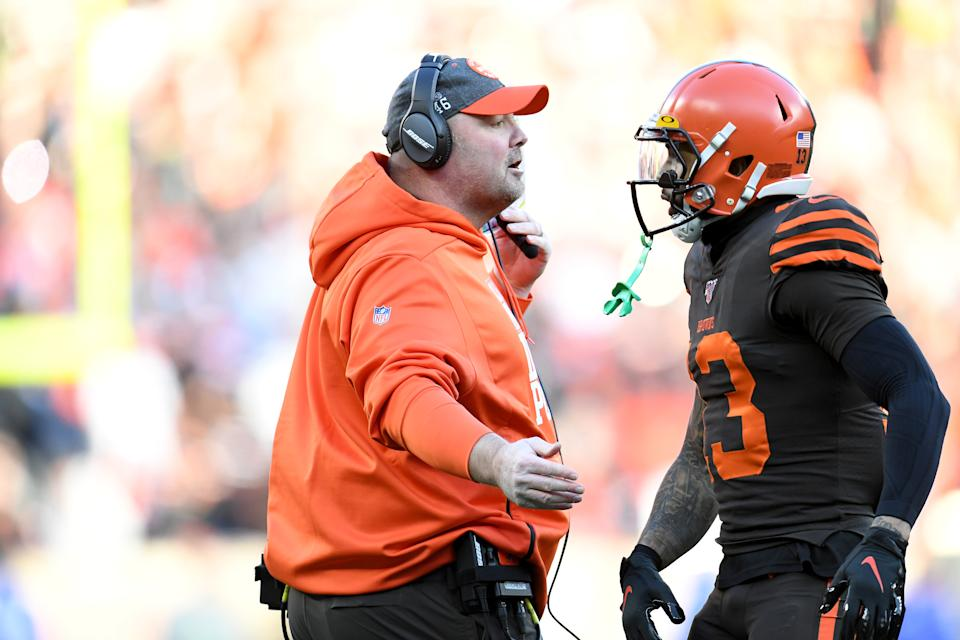 CLEVELAND, OHIO - DECEMBER 22: Head coach Freddie Kitchens congratulates wide receiver Odell Beckham #13 of the Cleveland Browns as Beckham leaves the field during the second half against the Baltimore Ravens at FirstEnergy Stadium on December 22, 2019 in Cleveland, Ohio. The Ravens defeated the Browns 31-15.  (Photo by Jason Miller/Getty Images)